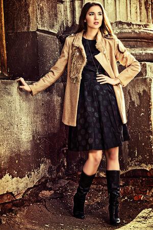 Beautiful brunette woman standing on the city street. Stock Photo - 24254038