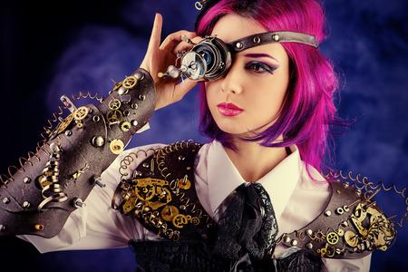 暗いでポーズ様式化されたスチーム パンク衣装の女の子。キャラクター。