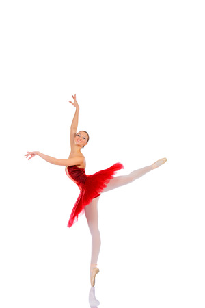 Professional ballet dancer posing at studio. Isolated over white .