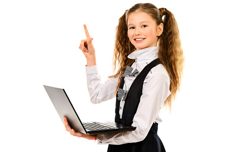 Portrait of a schoolgirl holding a laptop, isolated on white background