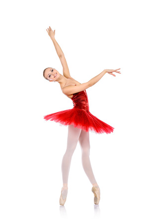 Professional ballet dancer posing at studio. Isolated over white background.
