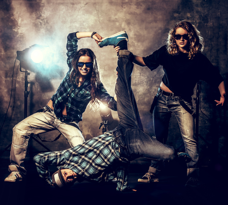 Group of modern dancers over grunge Stock Photo - 28826584