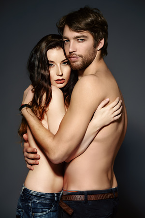 Beautiful passionate naked couple in love.  photo