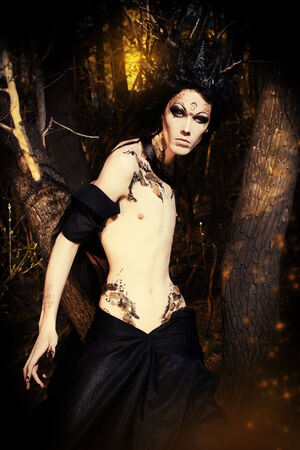 A fantasy hero in a wild desolate forest. Art project. Fantasy. Halloween. photo