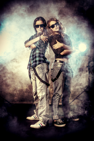 Modern hip-hop dancers over grunge background photo