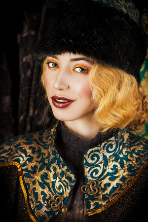 Portrait of a beautiful fashion model in a rich historical costume. Fur clothing. Vintage. Luxury style.  photo