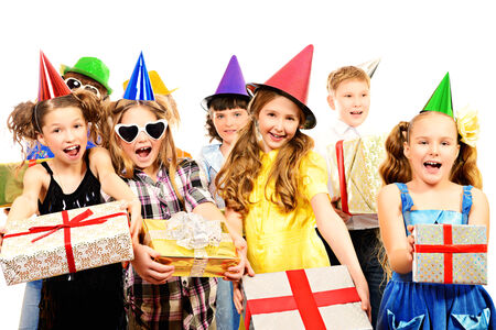 happy teens: Happy kids having fun at a party. Holidays. Gifts. Isolated over white.
