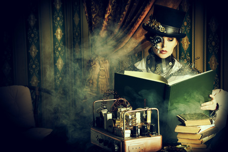 Portrait of a beautiful steampunk woman over vintage background. Banco de Imagens