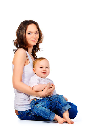 Happy mother with her little baby. Isolated over white. Stock Photo