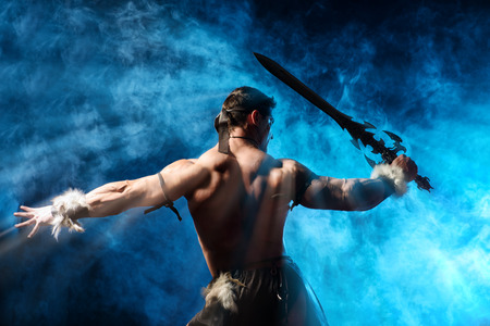 Portrait of a handsome muscular ancient warrior with a sword. Stok Fotoğraf - 32090336