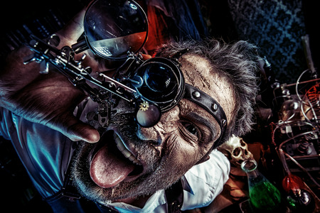Portrait of a crazy medieval scientist working in his laboratory. Alchemist. Halloween. Reklamní fotografie - 32553251