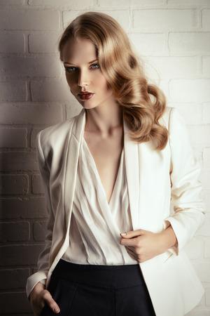 Fashion shot of a glamorous blonde woman. Successful business lady.