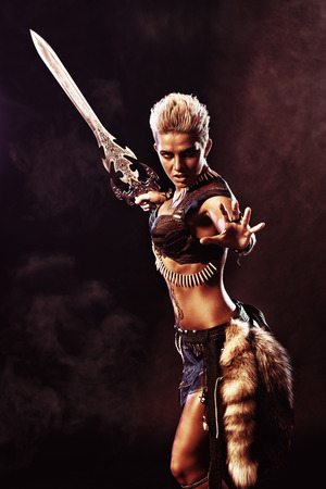 Portrait of a beautiful female warrior in battle. Ancient times. Amazon. Archivio Fotografico