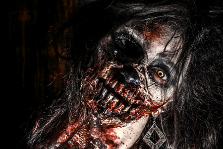 Close-up portrait of a scary bloody zombie girl. Horror. Halloween. Banco de Imagens