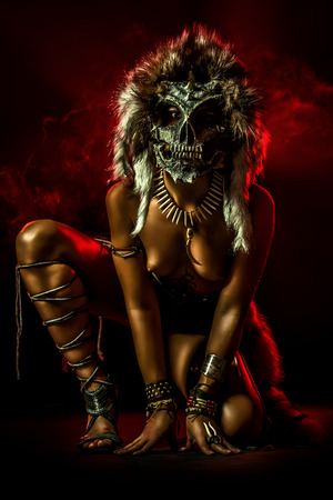 Close-up portrait of a beautiful nude Amazon in a mask. Ancient times. Fantasy. Ethnics. Stockfoto