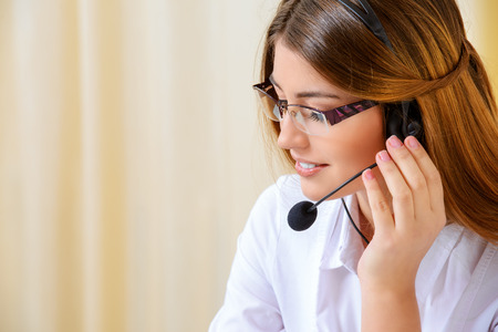 Friendly smiling young woman surrort phone operator at her workplace in the office. Headset. Customer service. Stok Fotoğraf - 35260882
