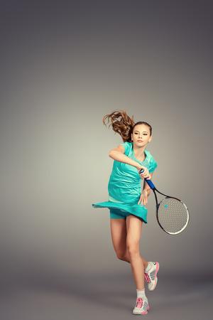 Full length portrait of a girl tennis player in motion. Studio shot. Banco de Imagens - 36467368