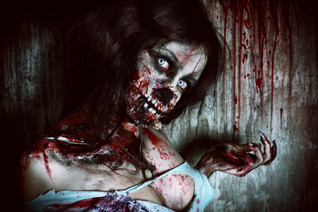 Close-up portrait of a scary bloody zombie girl. Horror. Halloween. 写真素材