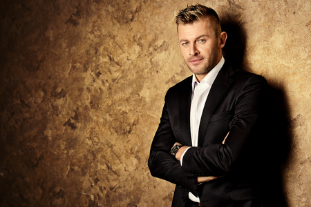 Portrait of a handsome mature man in elegant suit. Fashion, beauty. Banque d'images