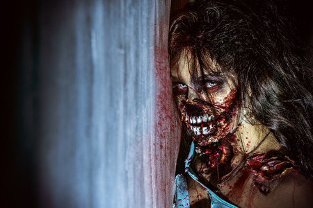 Close-up portrait of a scary bloody zombie girl. Horror. Halloween. 스톡 콘텐츠