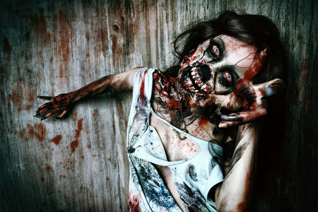 Close-up portrait of a scary bloody zombie girl. Horror. Halloween. Stock Photo - 38104768