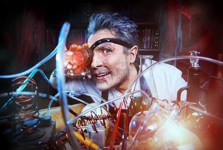 Portrait of a crazy medieval scientist working in his laboratory. Alchemist. Halloween. Stock Photo