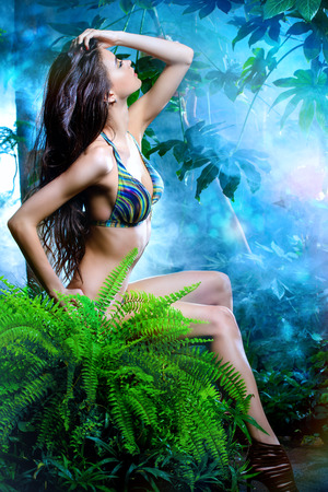 Beautiful sexy woman in bikini among tropical plants. Beauty, fashion. Spa, healthcare. Tropical vacation. Stock Photo - 41025501