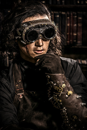 Portrait of a man steampunk in his research laboratory. Fantasy. Imagens - 41411900