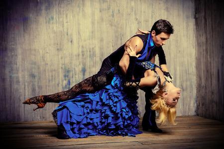 Two beautiful dancers perform the tango, Latin American dance 版權商用圖片
