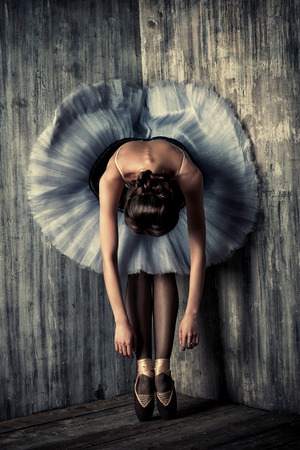 Professional ballet dancer resting after the performance. Art concept. Banco de Imagens