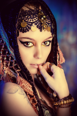 Close-up portrait of a magnificent traditional female dancer. Ethnic dance. Belly dancing. Tribal dancing. Make-up, cosmetics. Stock Photo