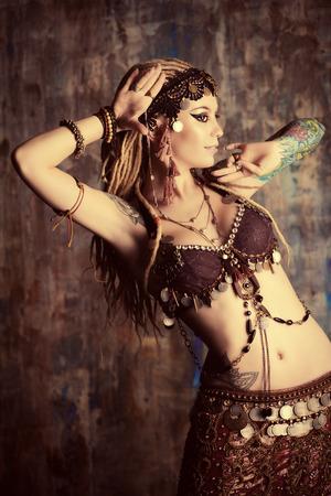 Art portrait of a beautiful traditional female dancer. Ethnic dance. Belly dancing. Tribal dancing.