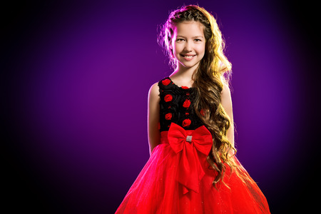 Portrait of a cute teen girl wearing beautiful festive dress. Beauty, childrens fashion. Studio shot. Zdjęcie Seryjne