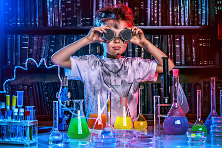 A boy doing experiments in the laboratory. Explosion in the laboratory. Science and education. Stok Fotoğraf - 44083030