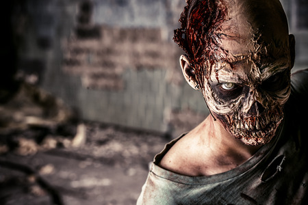 Horrible scary zombie man on the ruins of an old house. Horror. Halloween. 版權商用圖片 - 43776269