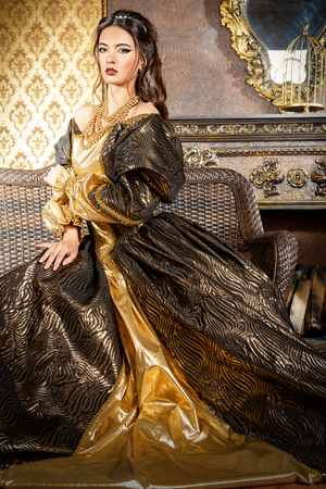 Renaissance Style -  beautiful young woman in the lush expensive dress in an old palace interior. Vintage style. Fashion. Stock fotó - 44513057