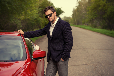 Handsome young man in his new sports car. Archivio Fotografico