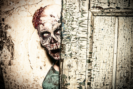 Horrible scary zombie man on the ruins of an old house Stock Photo