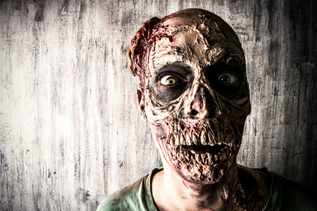 Close-up portrait of a horrible scary zombie man Stock Photo - 45250438