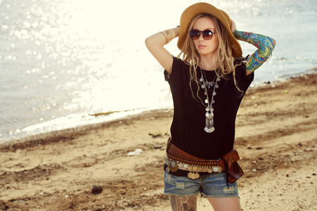 Romantic summer girl in boho style clothes walking along the riverside. Boho, hippie. 스톡 콘텐츠