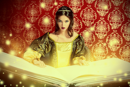 Fairy beautiful witch reads magic book of spells. Vintage style