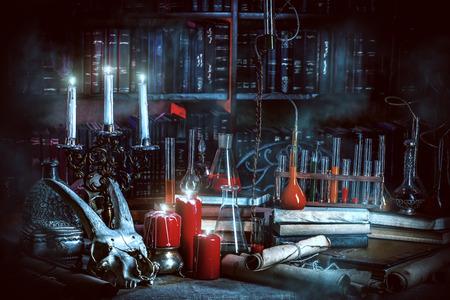 Medieval alchemist laboratory. Halloween. Fairy-tale interior. Standard-Bild
