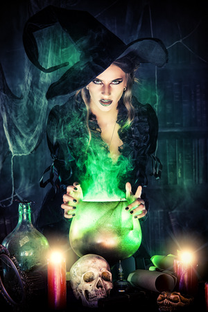 Attractive witch conjures in the wizarding lair.
