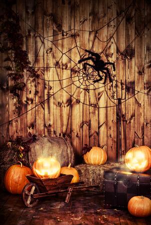Halloween pumpkin head jack lantern in barn interior.