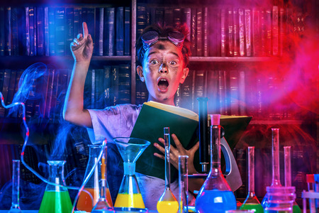 A boy doing experiments in the laboratory. Explosion in the laboratory. Science and education. Stock Photo - 49280304
