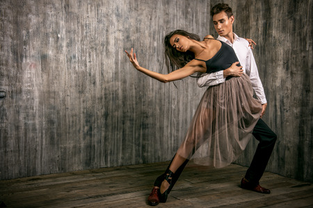 Beautiful couple of ballet dancers dancing over grunge background. Beauty, fashion. Reklamní fotografie - 48087317