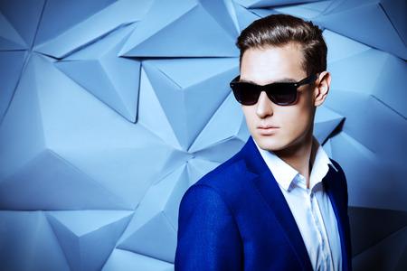 Close-up portrait of a handsome man in elegant classic suit and sunglasses. Men's beauty, fashion. Foto de archivo