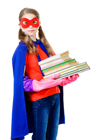 Cute girl teenager in a costume of superhero holding books. Isolated over white background.