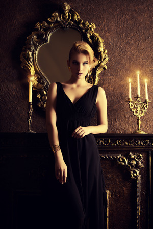Magnificent young woman in a luxurious classic interior. Beauty, fashion. Archivio Fotografico
