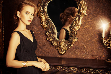 Magnificent young woman in a luxurious classic interior. Beauty, fashion. 写真素材